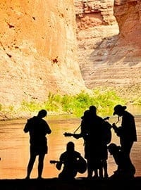 Musicians playing in Cataract Canyon