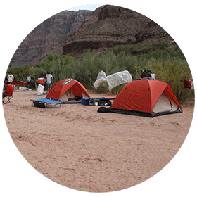 tents set up on Grand Canyon river trip