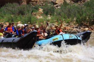 Grand Canyon raft splashing through rapids on the Colorado RIver