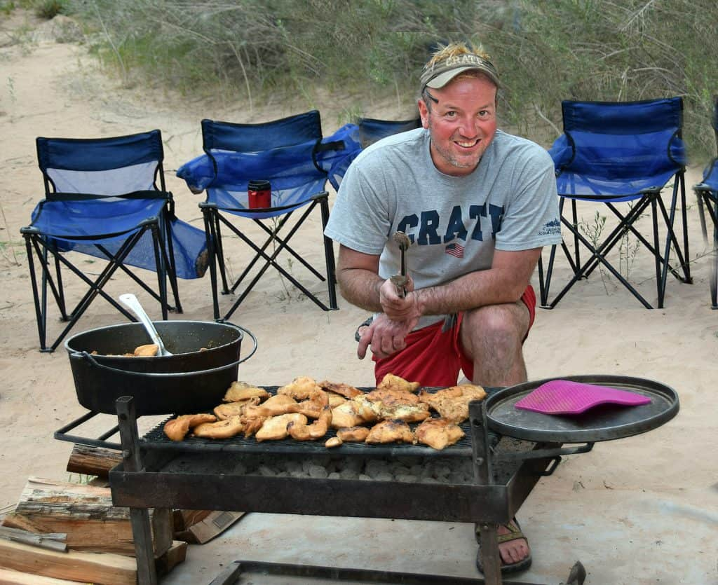 cooking bbq chicken along the banks of the Colorado River.