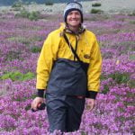 Mindy in a field of fireweed above Turnback Back Canyon on an Alsek River Rafting expedition.