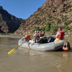 Paddling into Desolation Canyon on a Utah River rafting trip.