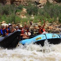 Grand Canyon raft splashing through rapids on the Colorado RIver
